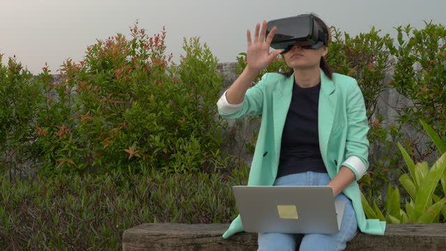 business woman in vr glasses works with a laptop - gesturing stock videos & royalty-free footage