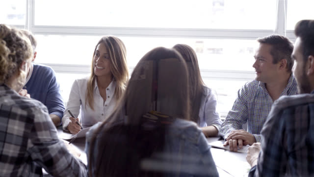 Business woman leading a meeting with her colleagues