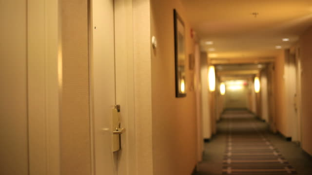 business woman leaving hotel room - entrance hall stock videos & royalty-free footage
