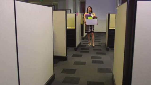 WS Business woman leaving office, Austin, Texas, USA
