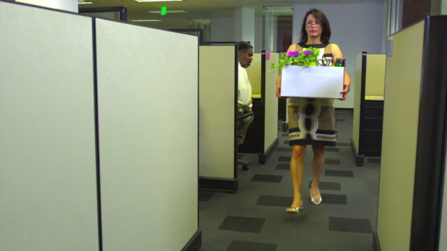 WS Business woman leaving office, colleague watching, Austin, Texas, USA