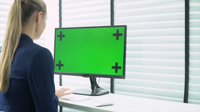 business woman looking computer green screen - over the shoulder view stock videos & royalty-free footage