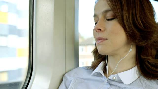 CU Business Woman looks out at the view from the train