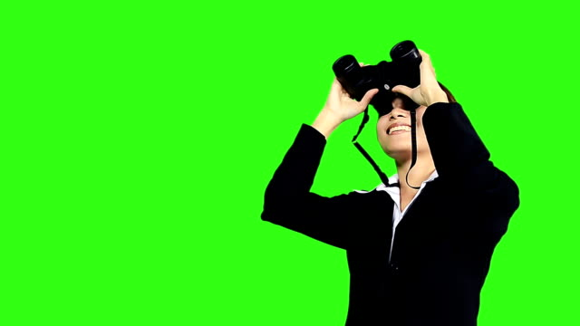 business woman looks to the future or job through binocular - keyable stock videos and b-roll footage