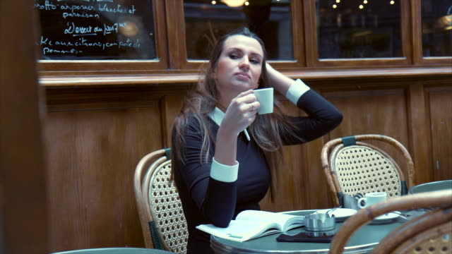 Business Woman on a Cafe Break (slow motion)