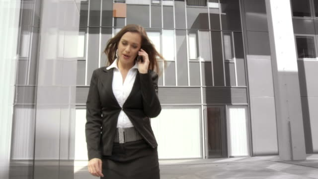 HD SLOW-MOTION: Business Woman On The Phone