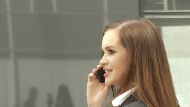 hd steadycam: business woman on the phone - spinning point of view stock videos & royalty-free footage