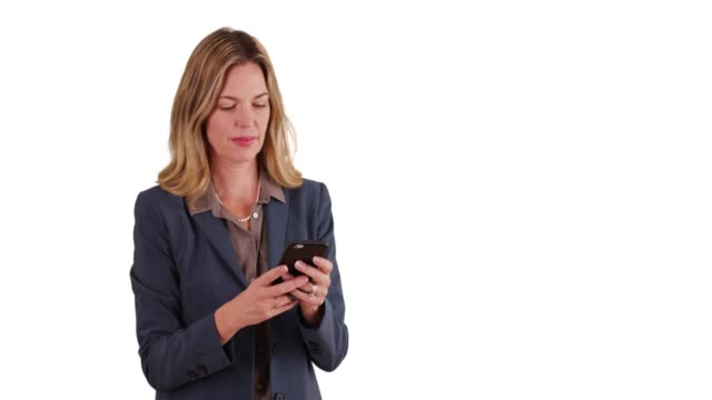 stockvideo's en b-roll-footage met business woman on white background with copy space messaging on smartphone - vaste stof