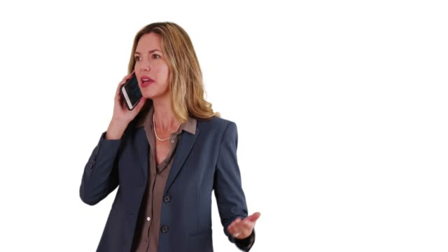 stockvideo's en b-roll-footage met business woman on white background with copy space talking on smartphone - vaste stof