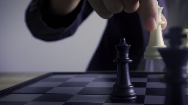 business woman play moving chess figure in competition success . strategy leadership concept. - scacchi video stock e b–roll