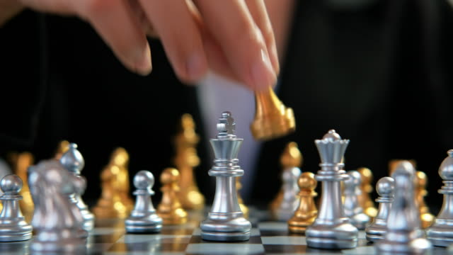 business woman playing chess battle game planning of leading strategy successful business leader - chess stock videos & royalty-free footage