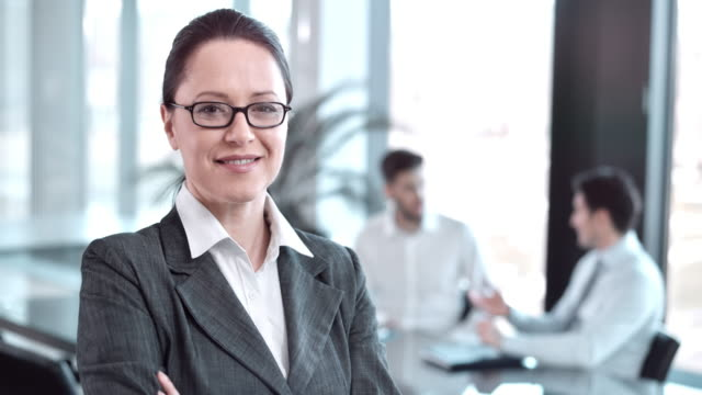 SLO MO DS business woman portrait in conference room