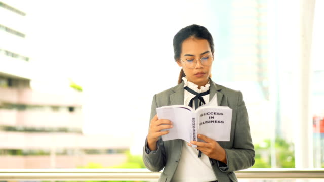 business woman reading business book and drink coffee in modern city. - coffee drink stock videos & royalty-free footage