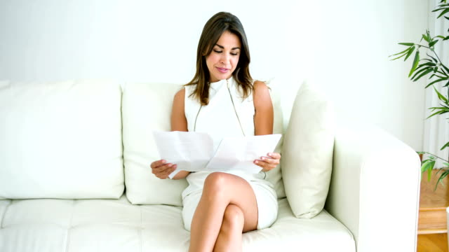 business woman reading documents - hot desking stock videos & royalty-free footage
