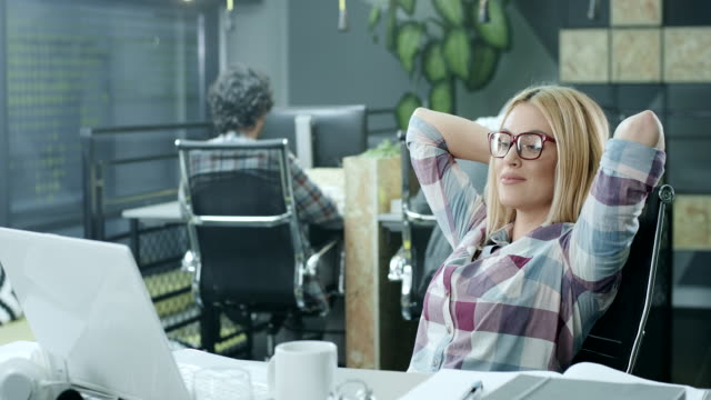 business woman relaxing at the office - blond hair stock videos & royalty-free footage