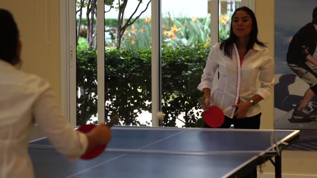 business woman relaxing with playing ping pong - table tennis stock videos & royalty-free footage