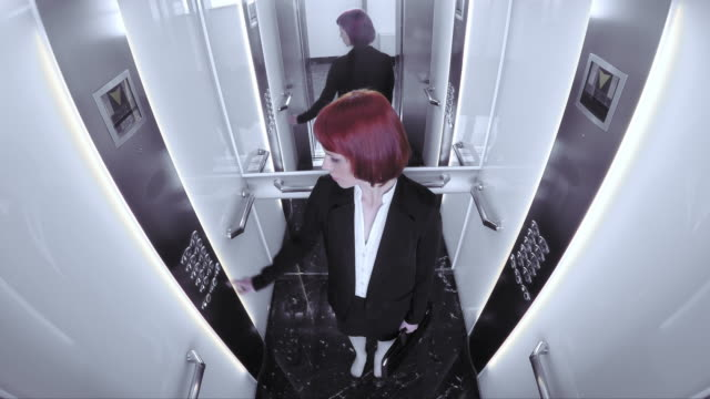 pov business woman riding in the elevator - elevator point of view stock videos and b-roll footage