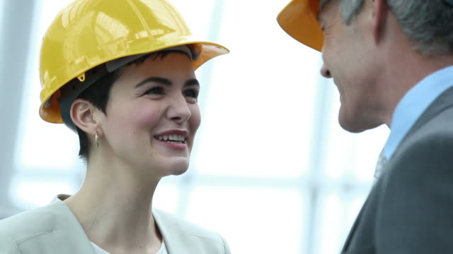 business woman shaking hands on construction site