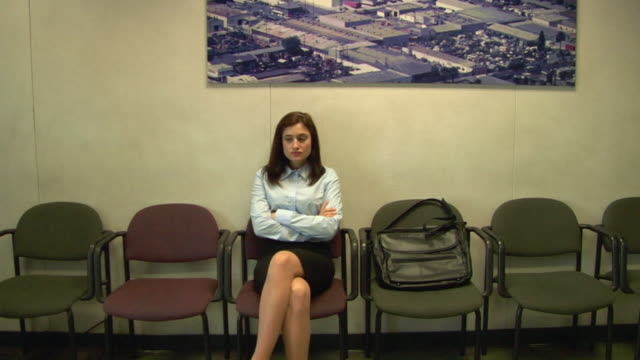 ms, business woman sitting in waiting room, compton, california, usa - sala d'attesa video stock e b–roll