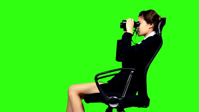 business woman sitting on a chair with binocular - binoculars stock videos & royalty-free footage