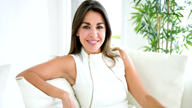 business woman sitting on a sofa - hot desking stock videos & royalty-free footage