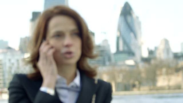 Business Woman takes a call outside offices