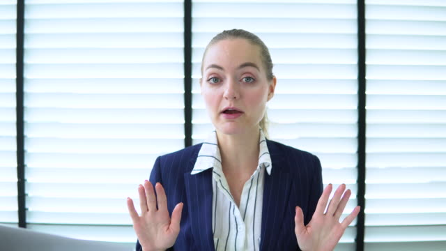 business woman talking with camera - webcam stock videos & royalty-free footage