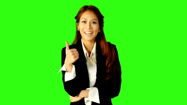 business woman thumb up with green screen background - keyable stock videos & royalty-free footage