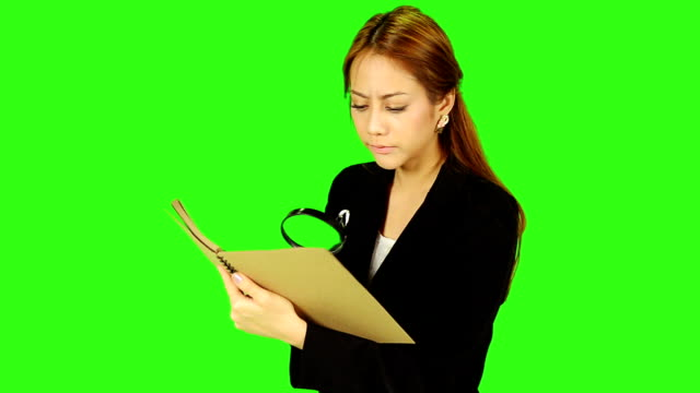 business woman use eyeglasses instead of magnifying glass - matte image technique stock videos & royalty-free footage