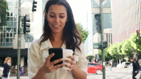 business woman using smart phone and drinking coffee on the go - real time stock videos & royalty-free footage