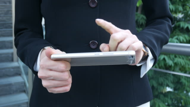 business woman using smartphone , index finger pointing