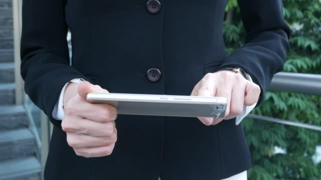 business woman using smartphone , index finger sliding