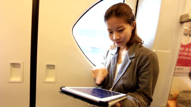 business woman  using tablet computer in electric train