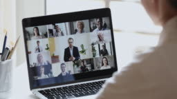 Business woman video conferencing boss and colleagues by online call
