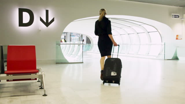 MS Business woman walking in airport terminal / Toulouse, Midi-Pyrennees, France
