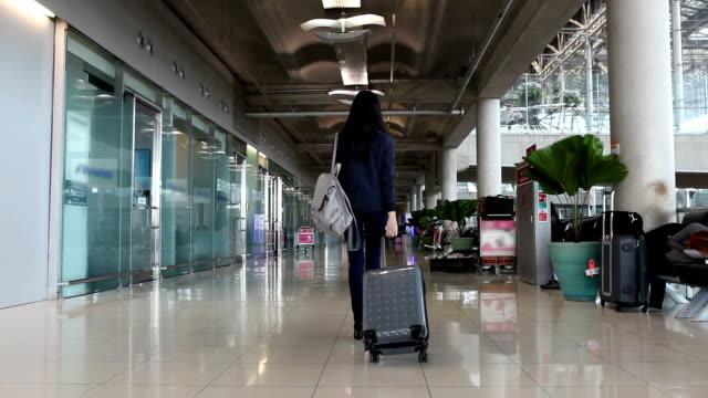 business woman walking in airport - toulouse stock videos & royalty-free footage