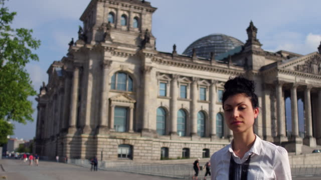 business woman walks away from the reichstag - politica video stock e b–roll