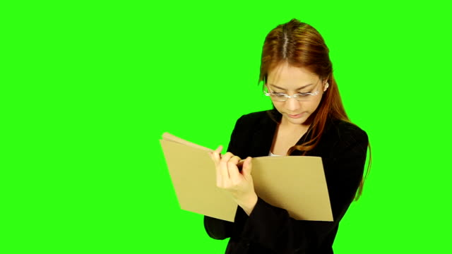 business woman wearing eyeglasses and reading book - keyable stock videos & royalty-free footage