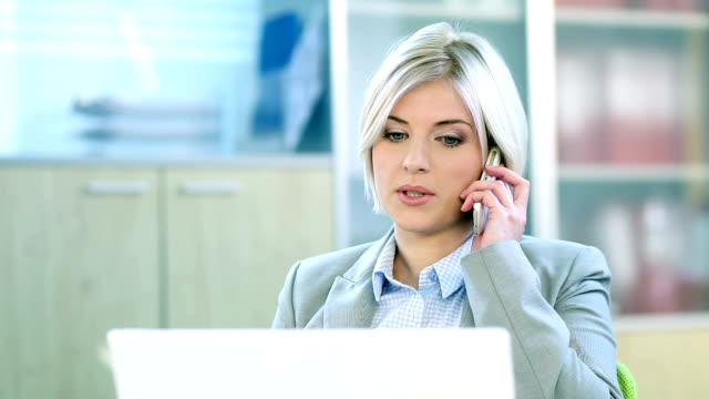 business woman with cell phone - blonde hair stock videos and b-roll footage