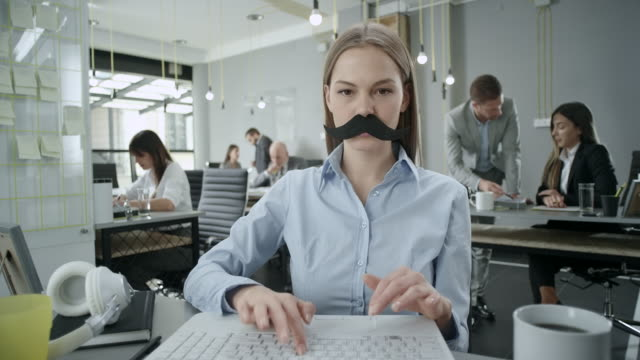 Business woman with fake mustaches