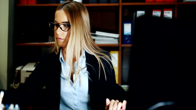 business woman with glasses using computer - administrator stock videos and b-roll footage