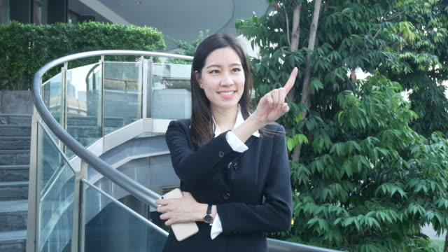 business woman working at outdoor office  , index finger in air