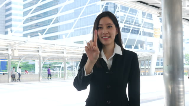 business woman working at urban Skyline , index finger in air