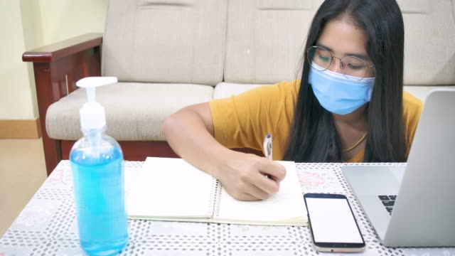 business woman working from home wearing protective mask. - hot desking stock videos & royalty-free footage