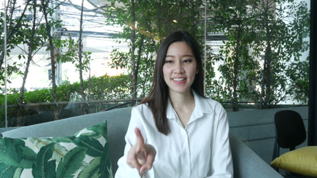 business woman working in coffee shop , index finger in air - index finger stock videos & royalty-free footage