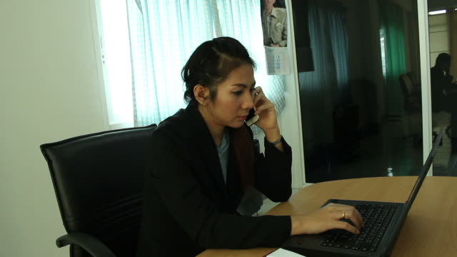 business woman working in office - home economics class stock videos & royalty-free footage