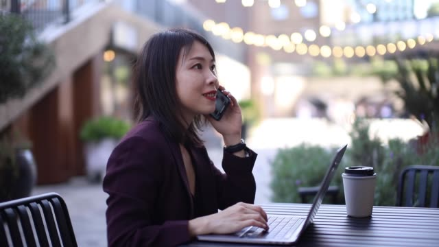 business woman working remotely with laptop at a cafe - businesswear stock videos & royalty-free footage