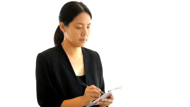 business woman writing on paper - file clerk stock videos & royalty-free footage