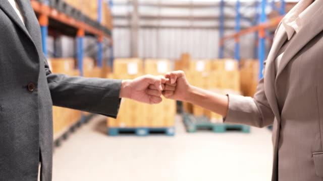 business woman's Hand Making Fist Bump