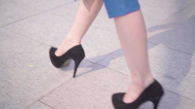 business woman's legs stepping in city. - scale video stock e b–roll